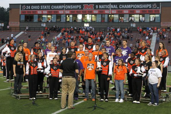 The WHS Advanced Choir performs the Alma Mater prior to the football game.